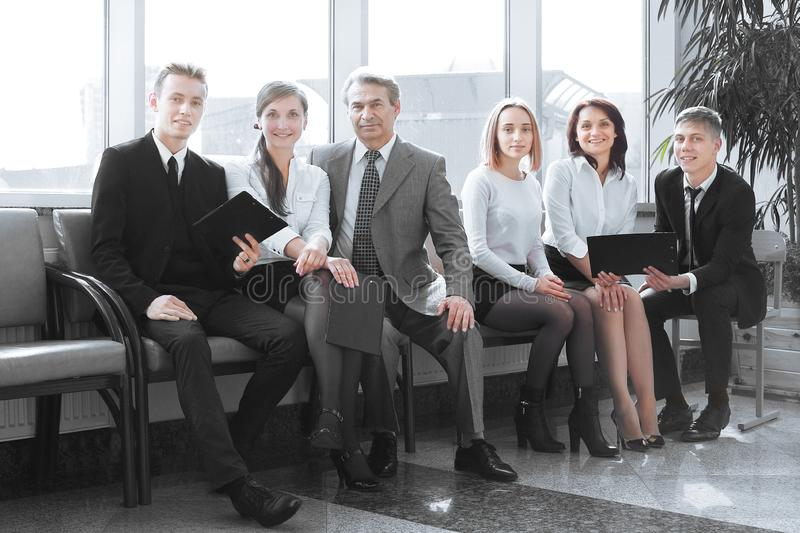 Professional business team sitting in the lobby of the office. stock image