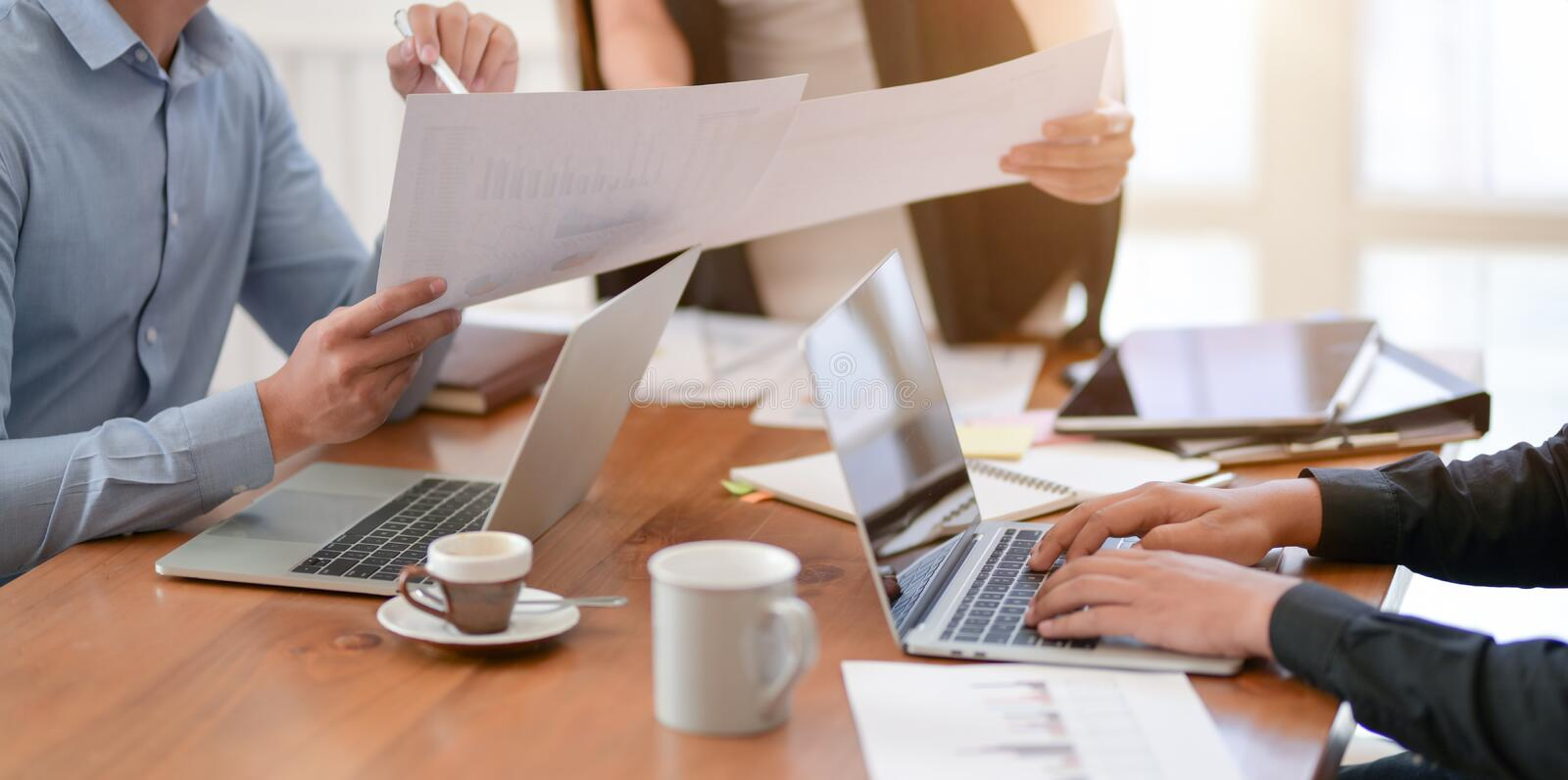 Professional business team working on their project together royalty free stock photo