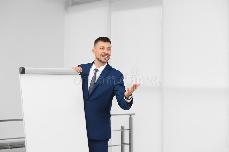 Professional business trainer  flip chart board indoors. Space for text stock image