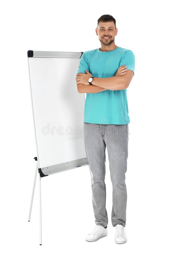 Professional business trainer near flip chart  on white background royalty free stock image