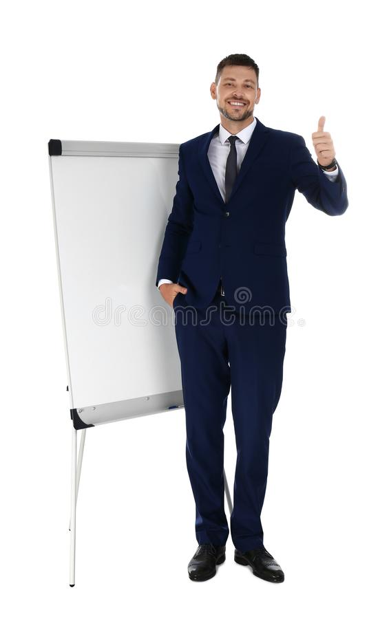 Professional business  near flip chart board on white background. Space for text royalty free stock photo