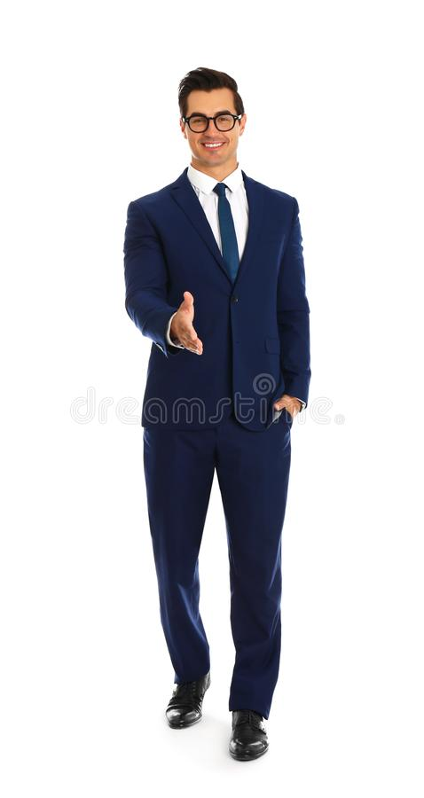 Professional business trainer offering handshake on background. Professional business trainer offering handshake on white background royalty free stock image