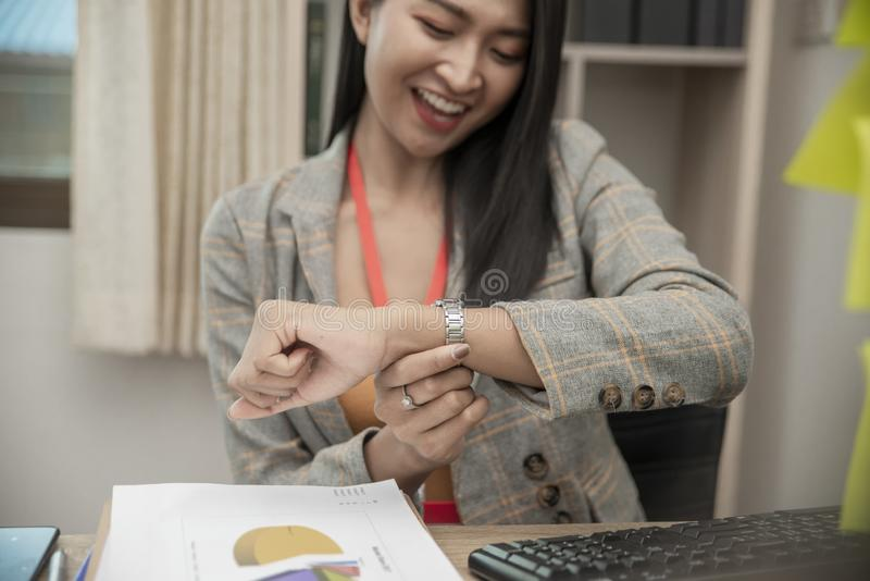 Professional Business woman seeing wrist watch stock images