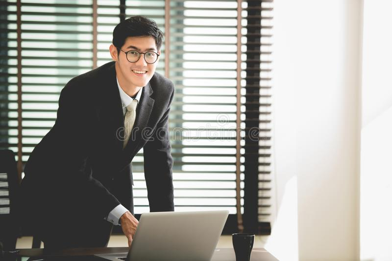 Professional businessman working on new project with notebook computer stock photography