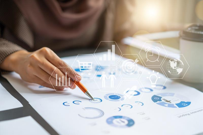 Professional Businesswoman checking in financial investment project graph chart report with financial investment related icon stock images