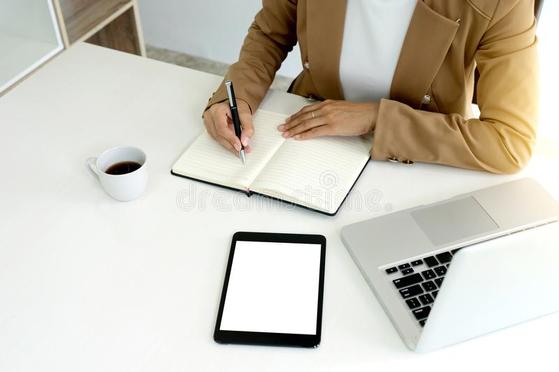 Professional businesswoman leader of the group work concept lady. Can run good business be alone working with computer and laptop. White tone office, with stock image