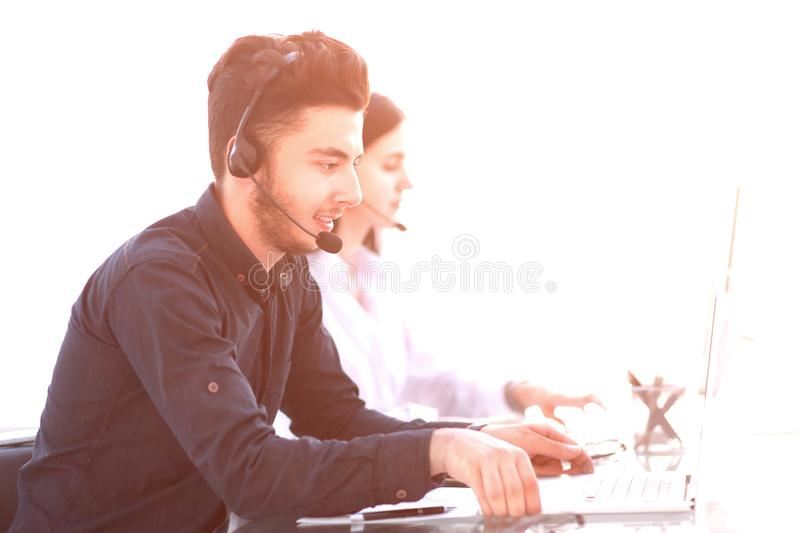 Professional call center operators communicate with customers. stock photography