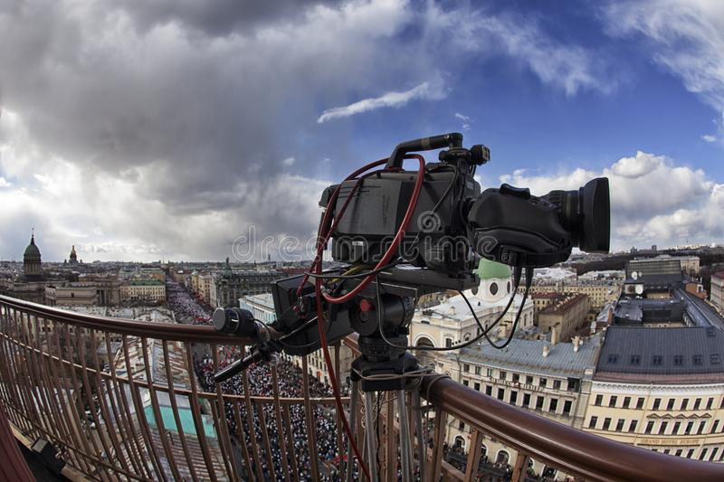 Professional digital video camera. Professional camcorder on the shooting of the cityscape stock images