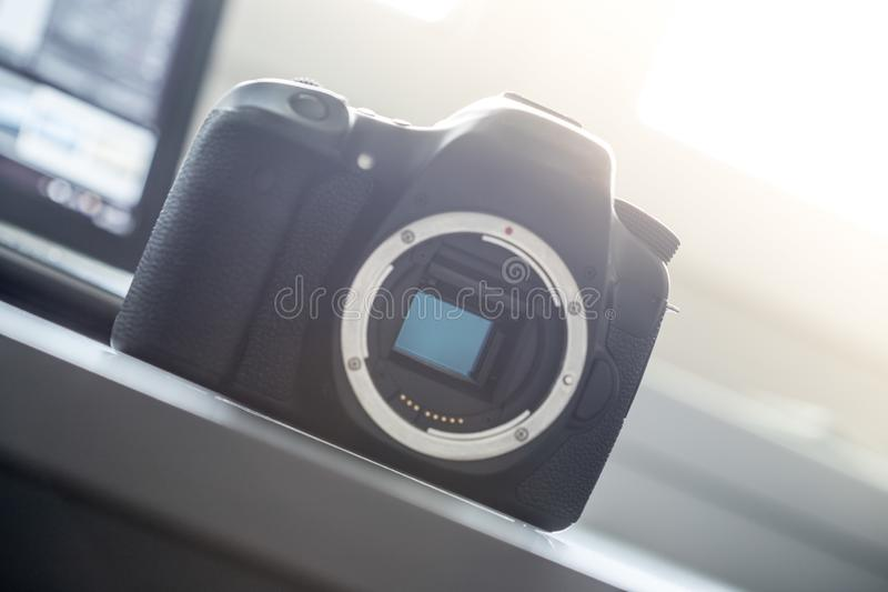 Professional camera: Reflex camera with open sensor. Professional reflex camera on a table, camera sensor, photography, photographer, lens, digital, review royalty free stock image