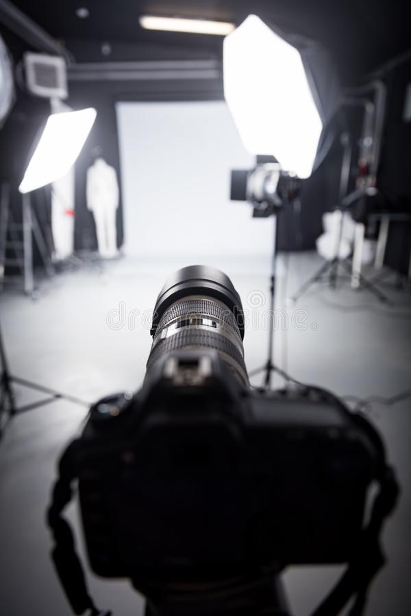 Professional camera set for a studio photo shoot. Focus on the camera lens royalty free stock photos