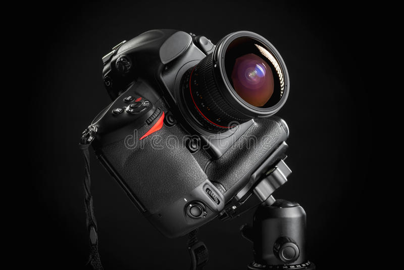 Professional camera with wide angle lens on tripod stock photo