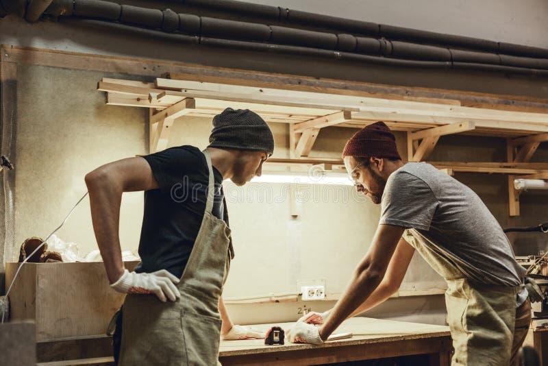 Professional carpenters making draft stock photo