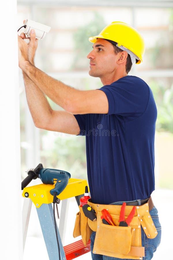 Cctv technician adjusting camera stock image
