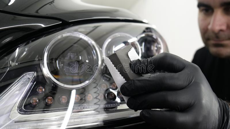 Professional ceramics handler apply different layers to the car using an applicator sponge, fiber immediately checking the effec. T. Concept from: Autodetailing royalty free stock images