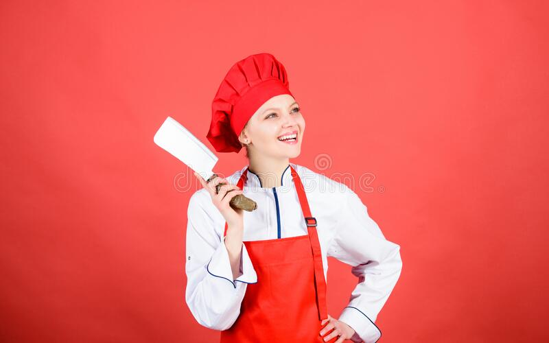 Professional chef in kitchen. Cuisine. happy woman cooking healthy food by recipe. butcher cut meat. Housewife with stock image