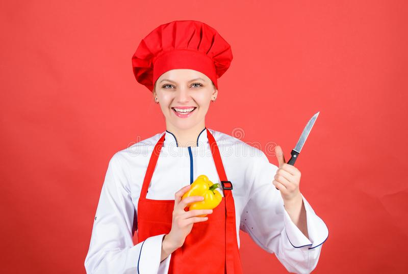 Professional chef in kitchen. Cuisine. happy woman cooking healthy food by recipe. sweet pepper. Housewife with cooking. Knife. woman in cook hat and apron stock images