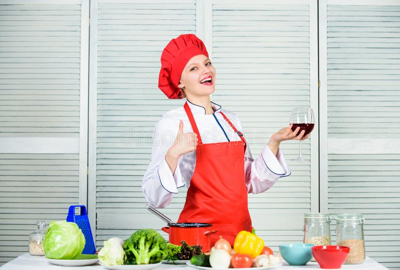 Professional chef in kitchen. happy woman cooking healthy food by recipe. restaurant menu. Dieting. organic eating and. Vegetarian. Housewife. woman in cook hat stock photography
