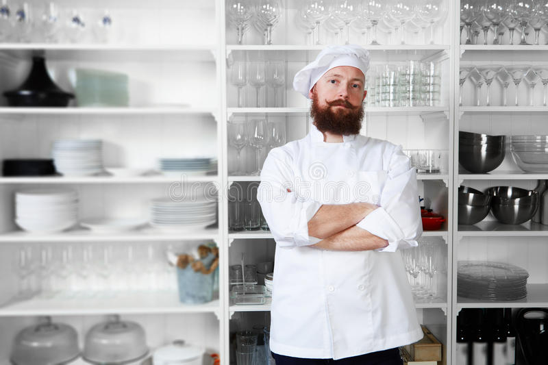 Professional chef stands in the background of modern kitchen expensive restaurant stock image