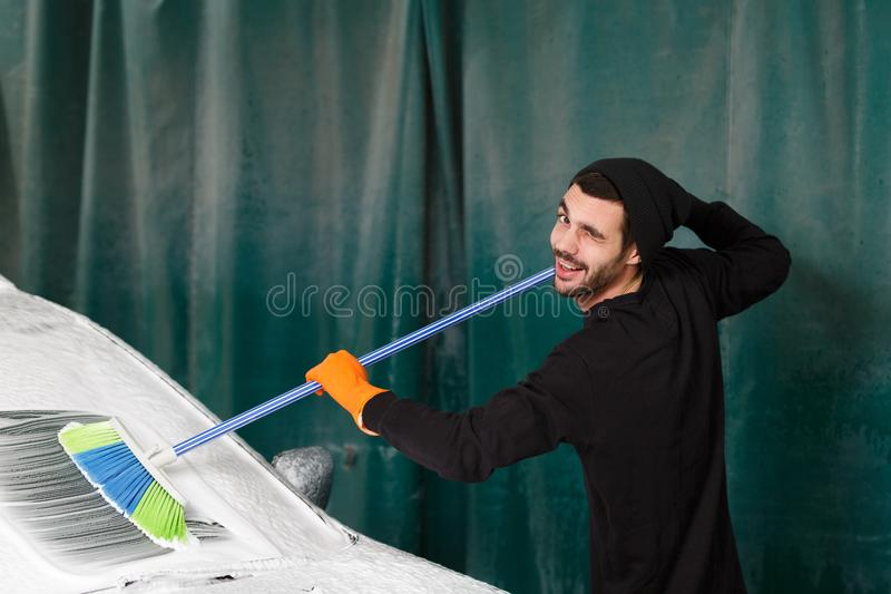 A professional cleaner washes a car royalty free stock photo