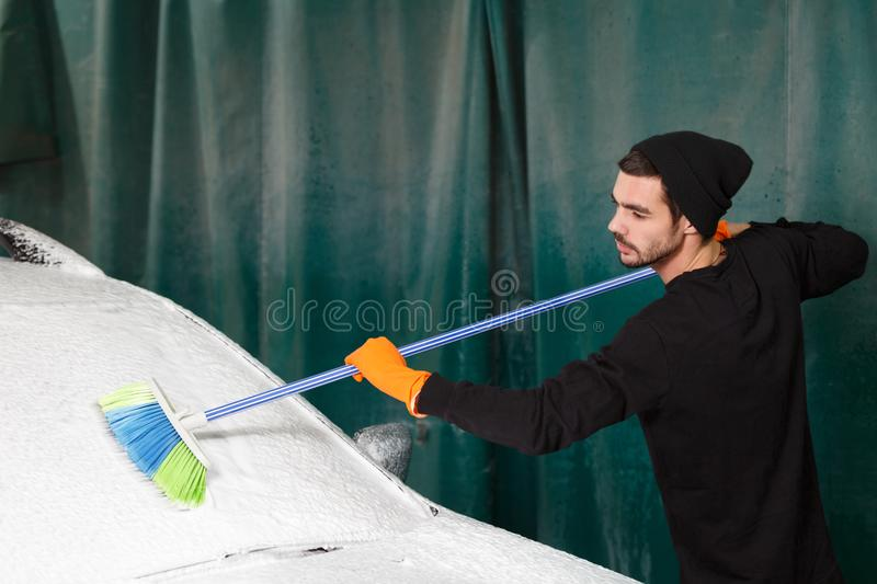 A professional cleaner washes a car royalty free stock photos