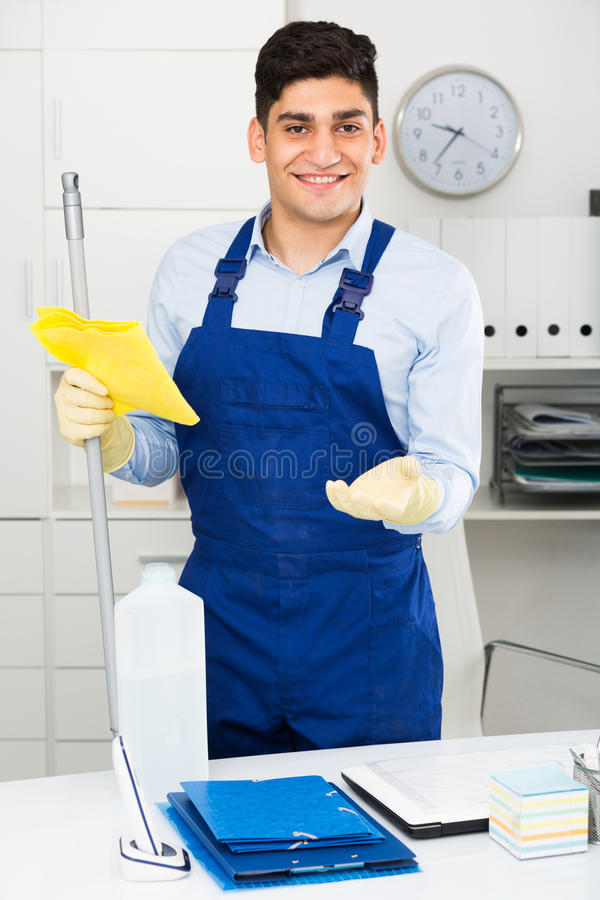 Professional cleaner is ready to clean the cabinet stock images