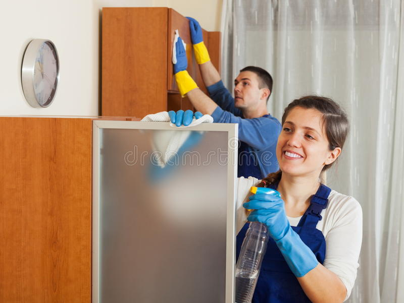 Professional cleaners team working stock images
