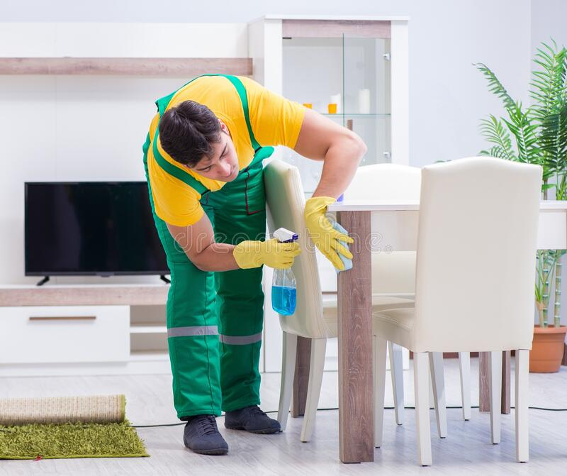 Professional cleaning contractor working at home royalty free stock photography