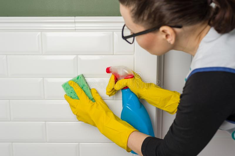 Professional cleaning service. Clean walls in the toilet stock images
