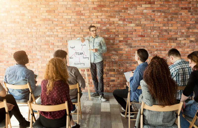 Professional coach making presentation to business team stock images