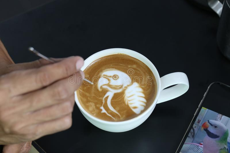 Professional of coffee latte barista making pattern the parrot i royalty free stock photo