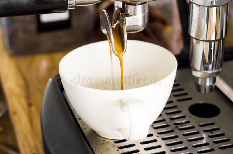 Professional coffee machine making espresso in a cafe royalty free stock photo