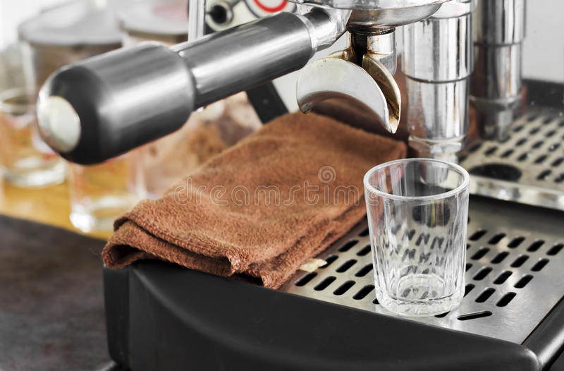 Professional coffee machine making espresso in a cafe stock photography