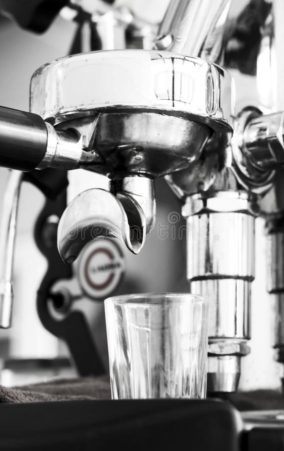 Professional coffee machine making espresso in a cafe stock images