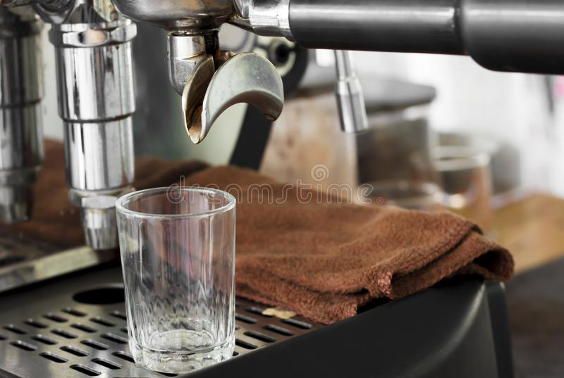 Professional coffee machine making espresso in a cafe royalty free stock photos