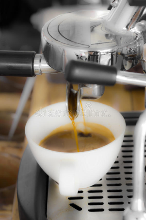 Professional coffee machine making espresso in a cafe, concept b stock image