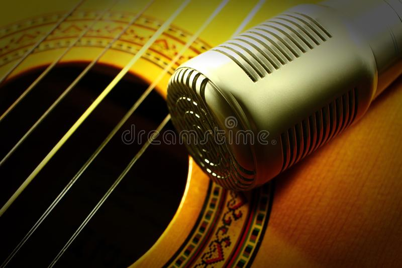 Professional condenser studio microphone, Closeup of playing guita royalty free stock photography
