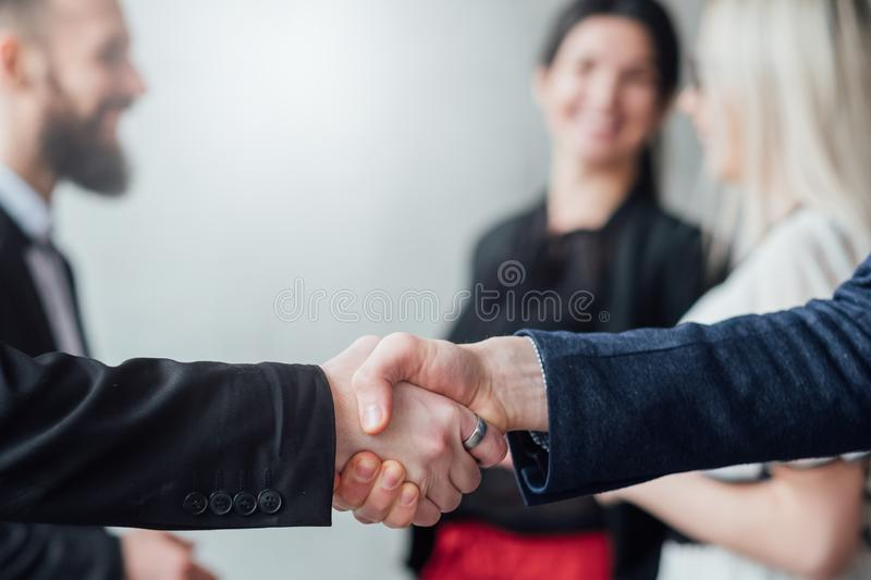Professional cooperation agreement handshake stock images