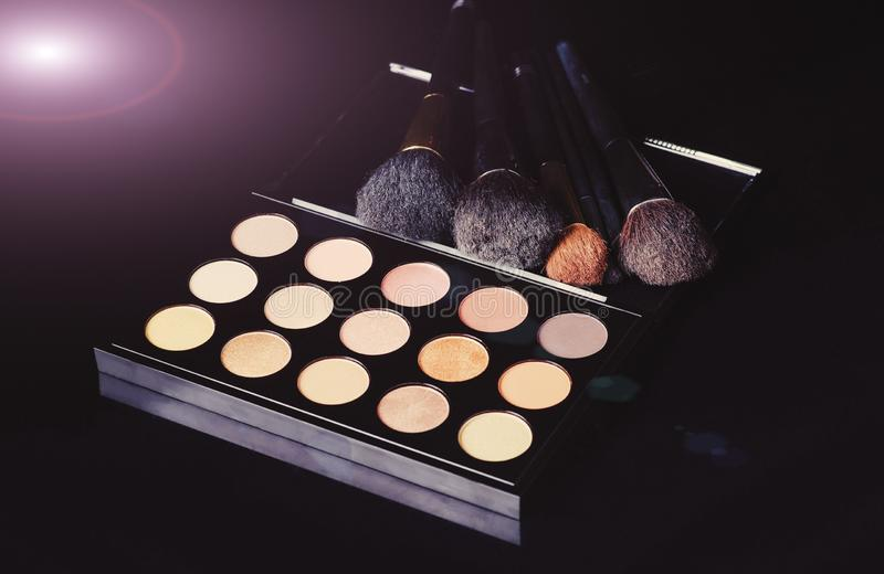 Professional cosmetics for make up. On black background, accessories, accessory, applicator, beautiful, beauty, blush, blusher, brown, brush, care, collection royalty free stock photo