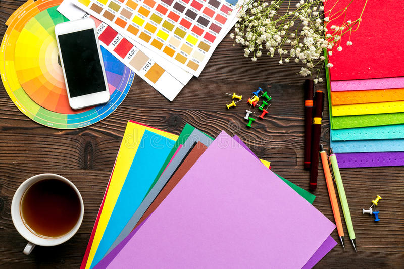 Professional creative graphic designer desk on wooden background top view royalty free stock photo