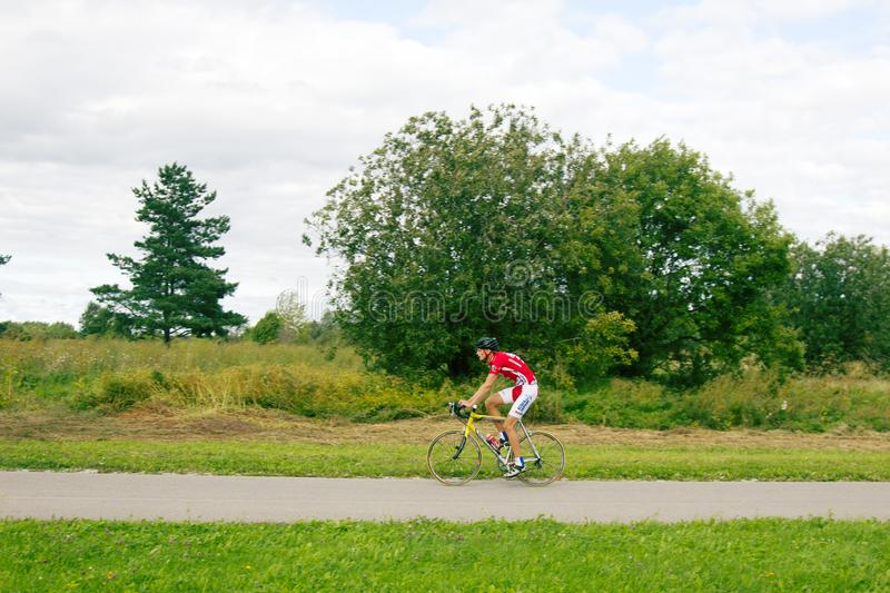 a professional cyclist on a yellow sports bike stock photography