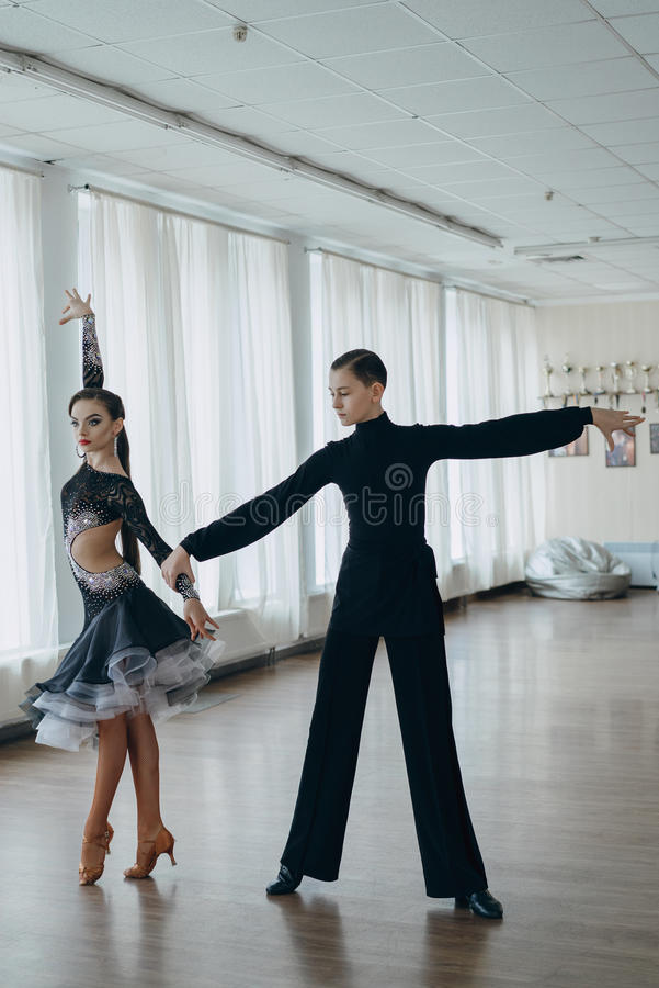 Professional dancers dancing in ballroom. Latin. royalty free stock photography