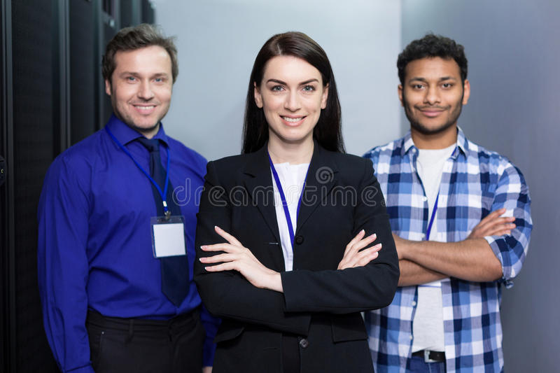 Professional delighted colleagues standing together. Great team. Professional delighted cheerful colleagues standing behind their leader and smiling while being royalty free stock photography