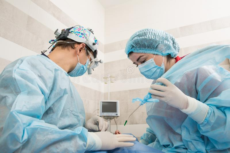 Professional dental checking and treatment. The dentist`s office. Doctor and assistant for the work process stock photos