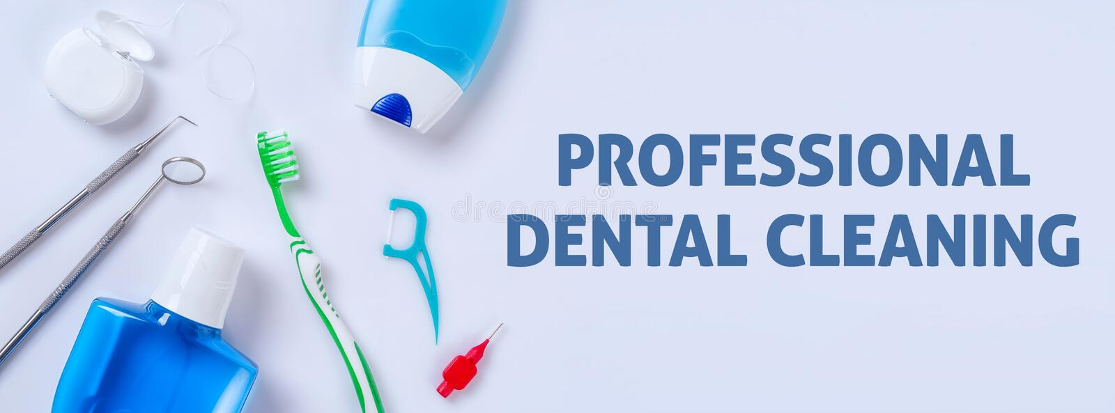 Professional dental cleaning. Oral care products on a light background - Professional dental cleaning stock photos