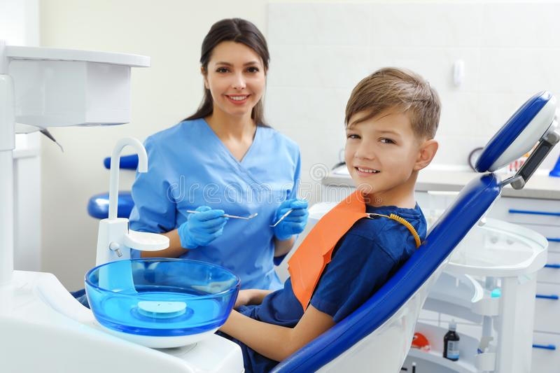 Professional dentist and little boy stock photos