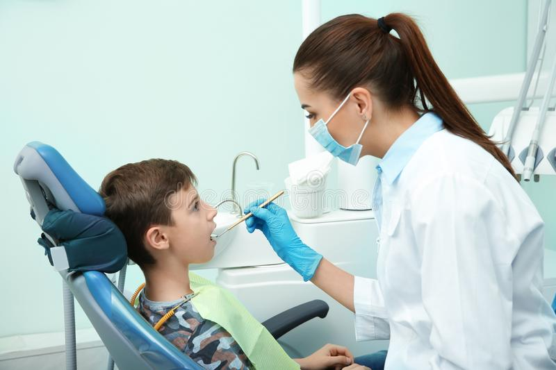 Professional dentist working with little patient royalty free stock photos