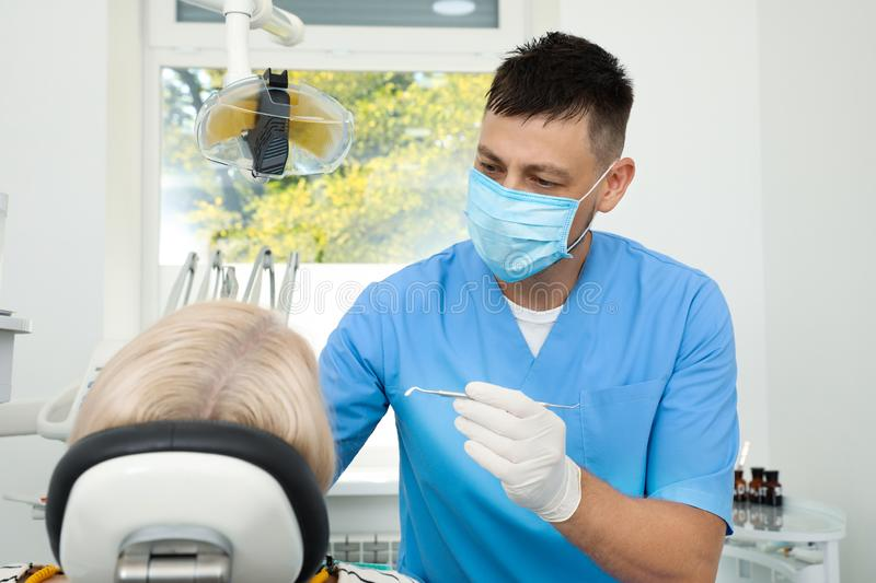 Professional dentist working with patient. In clinic stock photos
