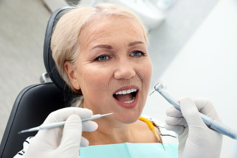 Professional dentist working with patient. In clinic stock photo