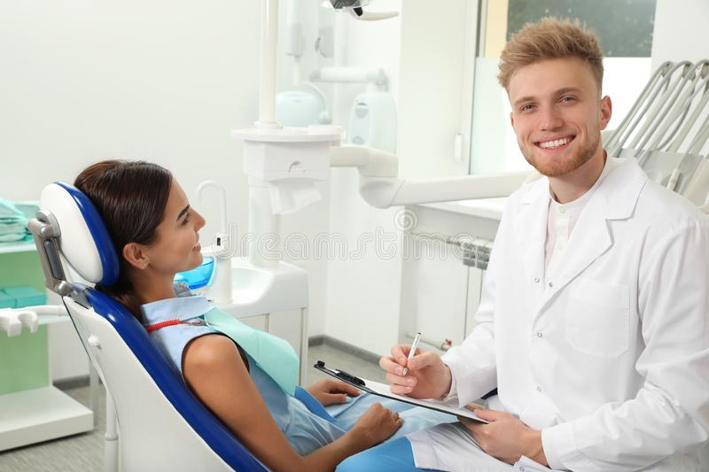 Professional dentist working with patient. In clinic royalty free stock photo