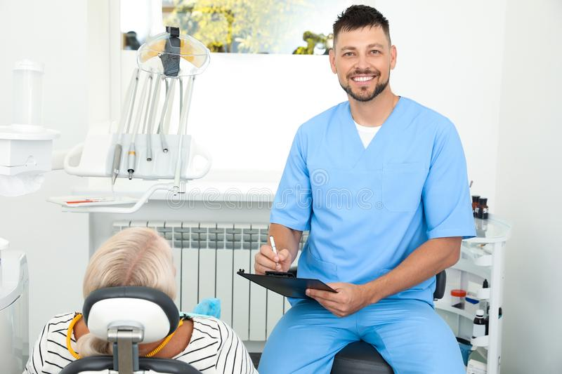 Professional dentist working with patient. In clinic royalty free stock photos
